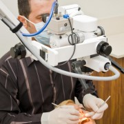 Dr Rammo looking into microscope #2, justSMILE Ramsgate Sydney NSW